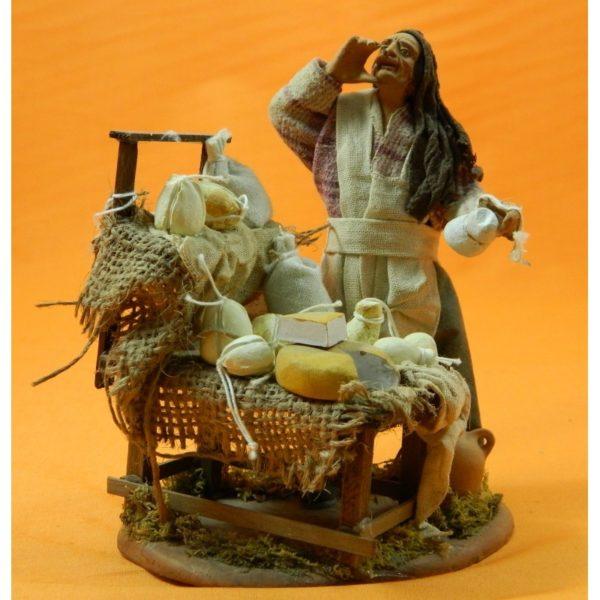 Venditore di formaggi con banco