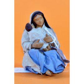 Donna seduta che abbraccia bimbo